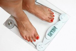 Лишний вес давит на стопы